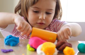 Girl_playing_with_playdough