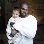 US rapper Kanye West, husband of US reality TV star Kim Kardashian, carries their daughter North, following a reported baptism ceremony at the Armenian St. James Cathedral in Jerusalem's Old City on April 13, 2015. AFP PHOTO / AHMAD GHARABLI (Photo credit should read AHMAD GHARABLI/AFP/Getty Images)
