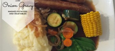 sausages mash vegies and onion gravy